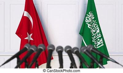 Flags of Turkey and Saudi Arabia at international meeting or...