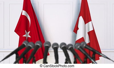 Flags of Turkey and Switzerland at international meeting or...