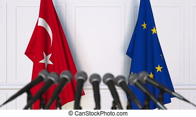 Flags of Turkey and the European Union at international meeting or negotiations press conference
