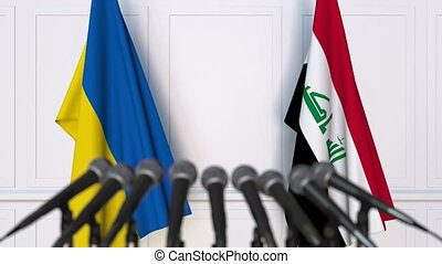 Flags of Ukraine and Iraq at international meeting or...