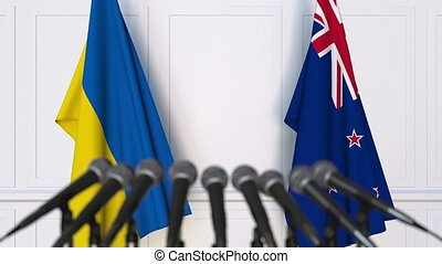 Flags of Ukraine and New Zealand at international meeting or...