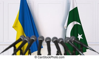 Flags of Ukraine and Pakistan at international meeting or...