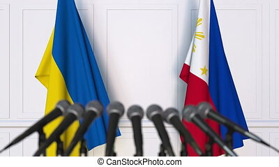 Flags of Ukraine and Philippines at international meeting or...