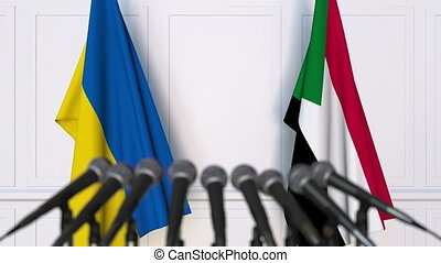 Flags of Ukraine and Sudan at international meeting or...