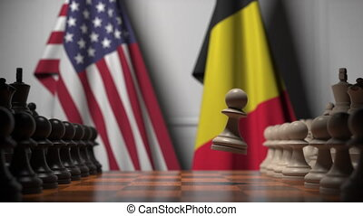 Flags of USA and Belgium behind pawns on the chessboard. Chess game or political rivalry related 3D animation
