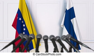 Flags of Venezuela and Finland at international meeting or...