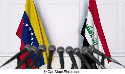 Flags of Venezuela and Iraq at international meeting or...
