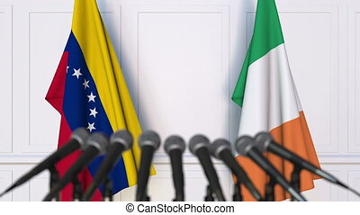 Flags of Venezuela and Ireland at international meeting or...
