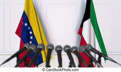 Flags of Venezuela and Kuwait at international meeting or...