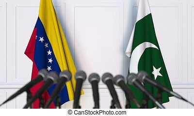 Flags of Venezuela and Pakistan at international meeting or...