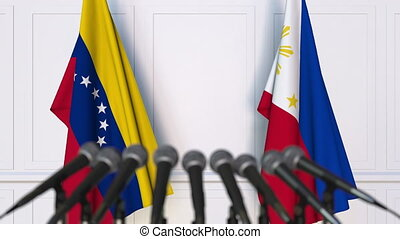 Flags of Venezuela and Philippines at international meeting...
