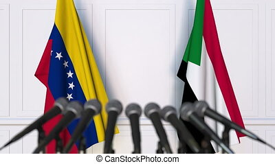 Flags of Venezuela and Sudan at international meeting or...