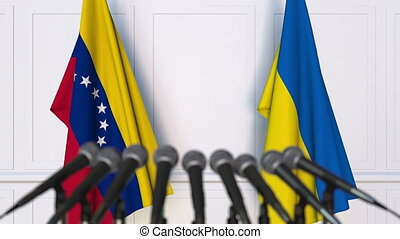 Flags of Venezuela and Ukraine at international meeting or...