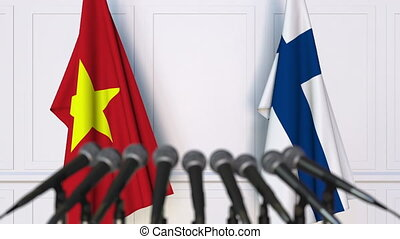 Flags of Vietnam and Finland at international meeting or...