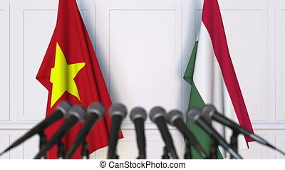 Flags of Vietnam and Hungary at international meeting or...