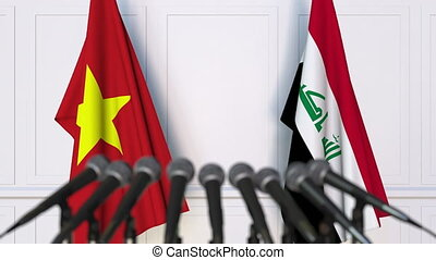 Flags of Vietnam and Iraq at international meeting or...