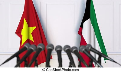 Flags of Vietnam and Kuwait at international meeting or...