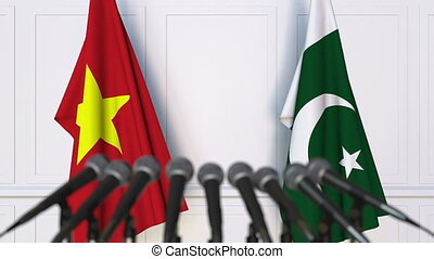 Flags of Vietnam and Pakistan at international meeting or...