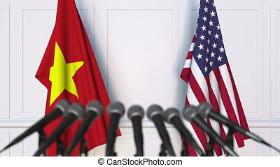 Flags of Vietnam and the United States at international...