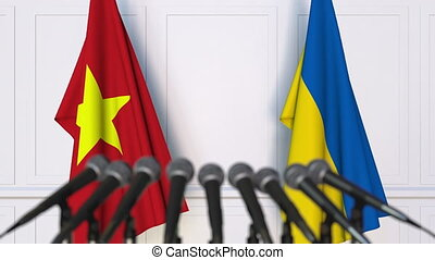Flags of Vietnam and Ukraine at international meeting or...