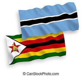 Flags of Zimbabwe and Botswana on a white background - ...