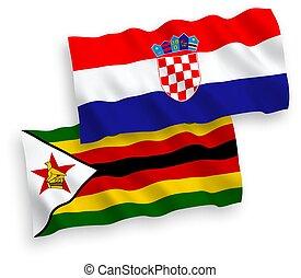 Flags of Zimbabwe and Croatia on a white background - ...