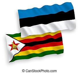 Flags of Zimbabwe and Estonia on a white background - ...