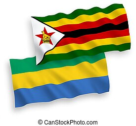 Flags of Zimbabwe and Gabon on a white background - National...