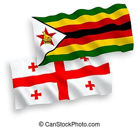 Flags of Zimbabwe and Georgia on a white background - ...