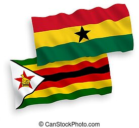 Flags of Zimbabwe and Ghana on a white background - National...