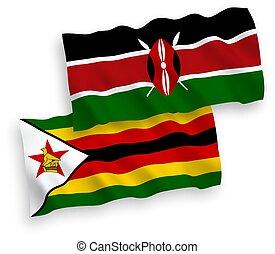 Flags of Zimbabwe and Kenya on a white background - National...