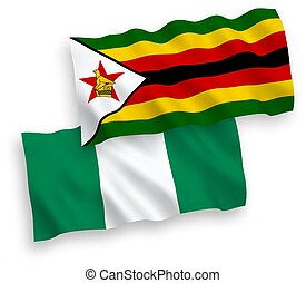 Flags of Zimbabwe and Nigeria on a white background - ...