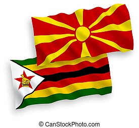 Flags of Zimbabwe and North Macedonia on a white background...