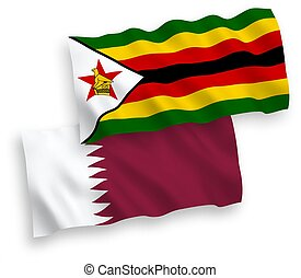 Flags of Zimbabwe and Qatar on a white background - National...
