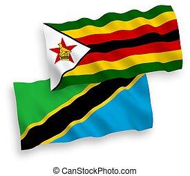 Flags of Zimbabwe and Tanzania on a white background - ...