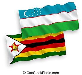 Flags of Zimbabwe and Uzbekistan on a white background - ...