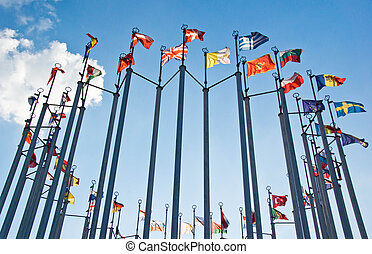 flags on background of blue sky with clouds
