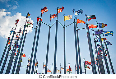 flags on background of sky with clouds