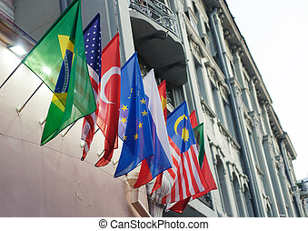 flags on the facade of the building