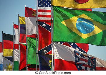 Flags - Waving international flags in blue sky