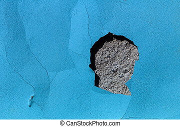 flaked blue color on a building, symbol photo for moisture and decay