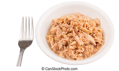 Flaked pieces of tuna in white bowl with a fork