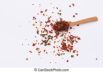 Flakes of red and green pepper.