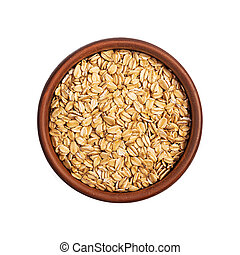 Flakes rolled oats in bowl isolated on white background. Top view