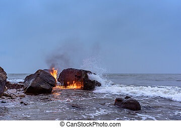 Flame between of the boulders