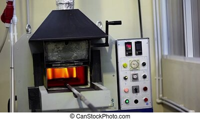 Flame burns inside annealing furnace, man came and closes it