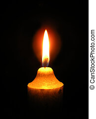 Flame from candle light – black background