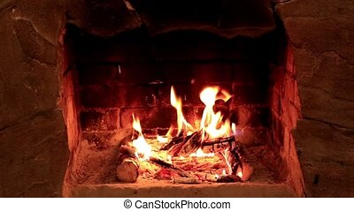 Flame in a fireplace with a dark background, Full HD