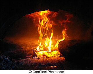 Flame in the furnace with pig-iron - The image of flame in...