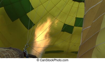Flame inside a hot air balloon - Zoom in shot of the inside...